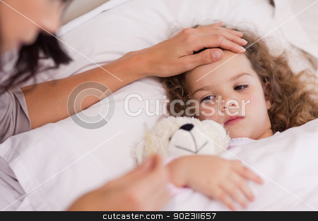 Mother taking care of her ill daughter stock photo, Young mother taking care of her ill daughter by Wavebreak Media