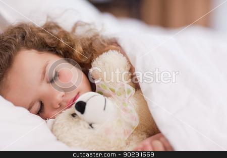 Girl sleeping with her teddy stock photo, Little girl sleeping with her daddy by Wavebreak Media