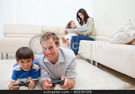 Family enjoys spending their leisure time together stock photo, Young family enjoys spending their leisure time together by Wavebreak Media