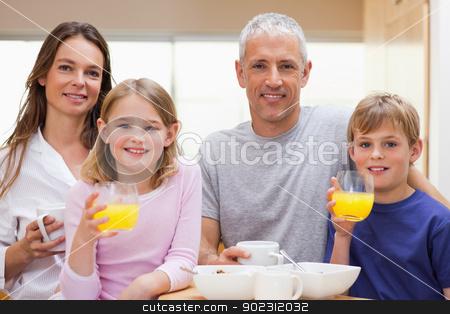 Happy family having breakfast stock photo, Happy family having breakfast in their kitchen by Wavebreak Media