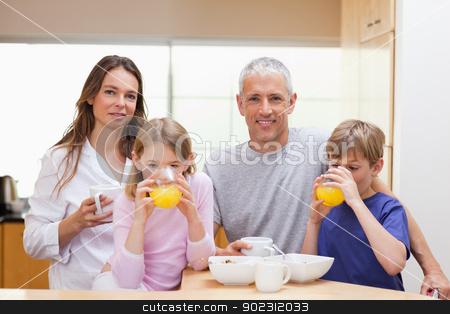 Smiling family having breakfast stock photo, Smiling family having breakfast in their kitchen by Wavebreak Media