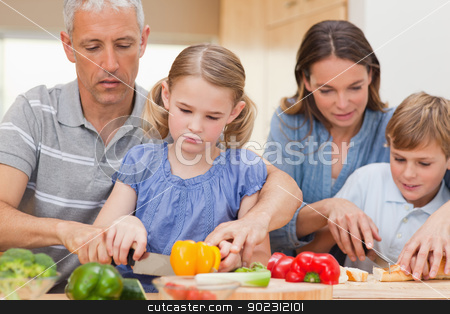 Family cooking together stock photo, Family cooking together at home by Wavebreak Media