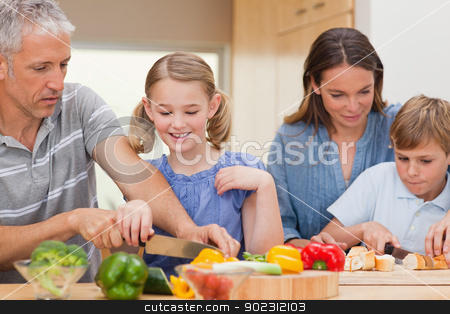 Lovely family cooking stock photo, Lovely family cooking in their kitchen by Wavebreak Media