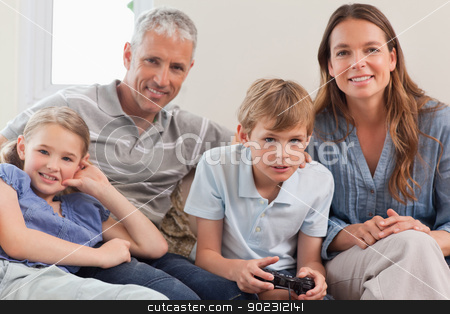 Family playing video games stock photo, Family playing video games in living room by Wavebreak Media