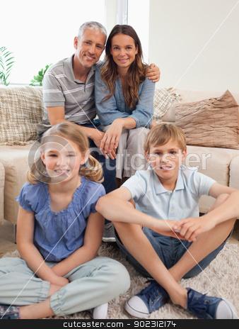 Portrait of a family posing stock photo, Portrait of a family posing in a living room by Wavebreak Media