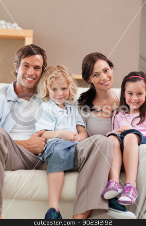 Portrait of a family watching television together stock photo, Portrait of a family watching television together in a living room by Wavebreak Media