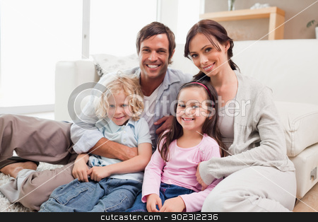 Family relaxing on a sofa stock photo, Family relaxing on a sofa in a living room by Wavebreak Media