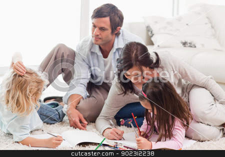 Family drawing together stock photo, Family drawing together in a living room by Wavebreak Media