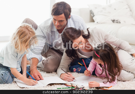 Beautiful family drawing together stock photo, Beautiful family drawing together in a living room by Wavebreak Media