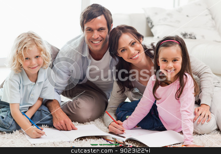 Charming family drawing together stock photo, Charming family drawing together in a living room by Wavebreak Media