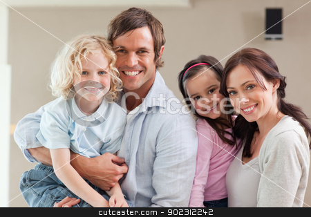 Lovely family posing stock photo, Lovely family posing while looking at the camera by Wavebreak Media