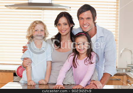 Family standing up stock photo, Family standing up in a kitchen by Wavebreak Media