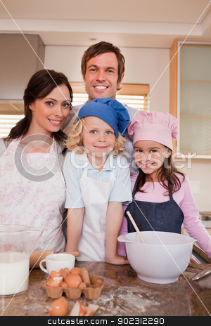 Portrait of a family baking together stock photo, Portrait of a family baking together in a kitchen by Wavebreak Media