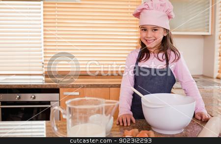 Little girl baking stock photo, Little girl baking in a kitchen by Wavebreak Media