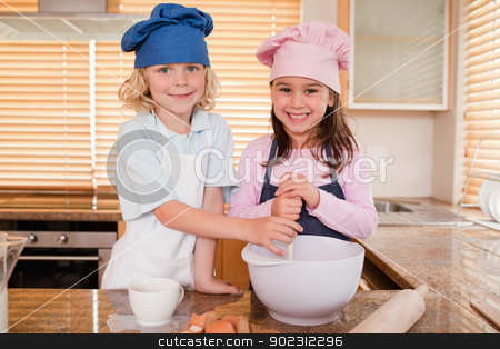 Siblings baking together stock photo, Siblings baking together in a kitchen by Wavebreak Media