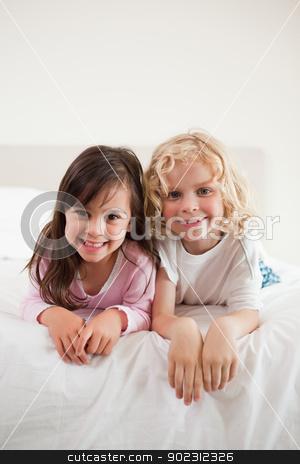 Portrait of siblings lying on their bellies stock photo, Portrait of siblings lying on their bellies by Wavebreak Media