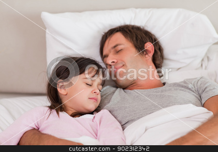 Father sleeping with his daughter stock photo, Father sleeping with his daughter in a bedroom by Wavebreak Media