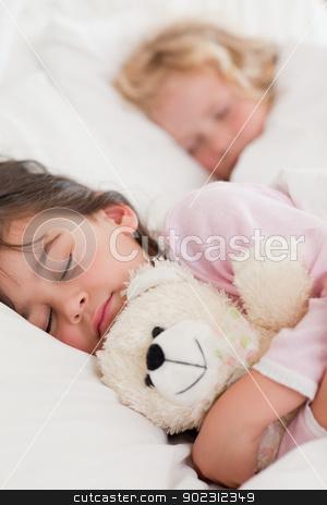 Portrait of calm children sleeping stock photo, Portrait of calm children sleeping in a bedroom by Wavebreak Media