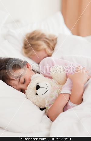 Portrait of children sleeping stock photo, Portrait of children sleeping in a bedroom by Wavebreak Media