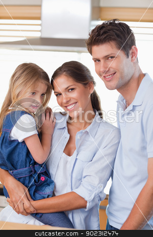 Portrait of a family posing stock photo, Portrait of a family posing in their kitchen by Wavebreak Media