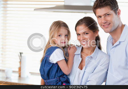 Young family posing stock photo, Young family posing in their kitchen by Wavebreak Media