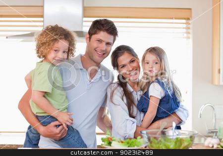 Happy family posing stock photo, Happy family posing in their kitchen by Wavebreak Media