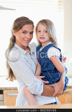 Portrait of a mother and her daughter posing stock photo, Portrait of a mother and her daughter posing in their kitchen by Wavebreak Media