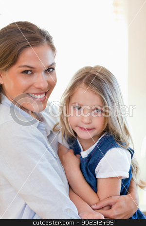 Portrait of a young mother and her daughter posing stock photo, Portrait of a young mother and her daughter posing together by Wavebreak Media