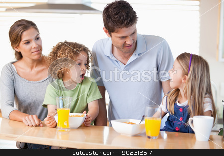 Family having breakfast stock photo, Family having breakfast in their kitchen by Wavebreak Media