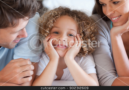 Close up of parents looking at their son stock photo, Close up of parents looking at their son while lying on a bed by Wavebreak Media