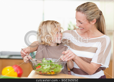 Happy mother and son preparing salad stock photo, Happy mother and son preparing salad together by Wavebreak Media