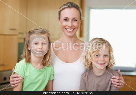 Mother with daughter and son in the kitchen stock photo, Mother with daughter and son in the kitchen together by Wavebreak Media