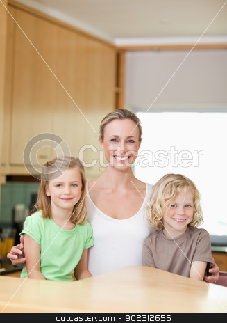 Mother with daughter and son in the kitchen together stock photo, Mother with her daughter and son in the kitchen together by Wavebreak Media