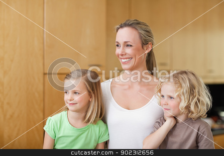 Side view of mother with daughter and son in the kitchen stock photo, Side view of mother with daughter and son in the kitchen together by Wavebreak Media