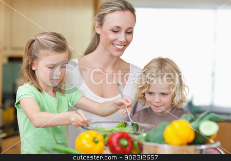 Mother with daughter and son preparing salad stock photo, Mother together with daughter and son preparing salad together by Wavebreak Media