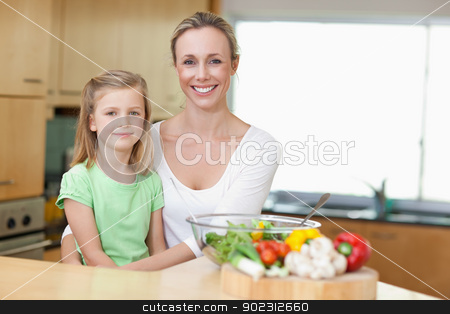 Mother and daughter in the kitchen stock photo, Mother and daughter in the kitchen together by Wavebreak Media