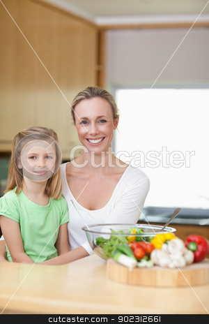 Smiling mother and daughter in the kitchen stock photo, Smiling mother and daughter in the kitchen together by Wavebreak Media