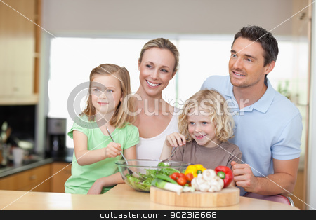 Family standing next to salad stock photo, Family standing together next to salad by Wavebreak Media