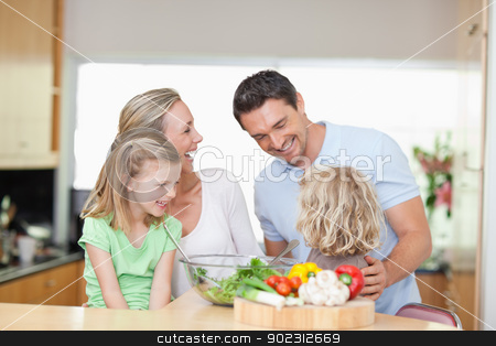 Happy family in the kitchen stock photo, Happy family together in the kitchen by Wavebreak Media