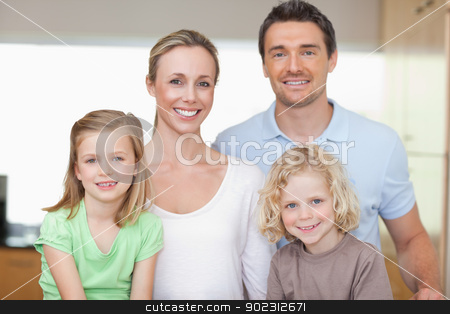 Cheerful family in the kitchen stock photo, Cheerful family together in the kitchen by Wavebreak Media
