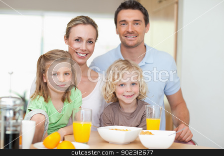 Family with healthy breakfast stock photo, Family together with healthy breakfast by Wavebreak Media
