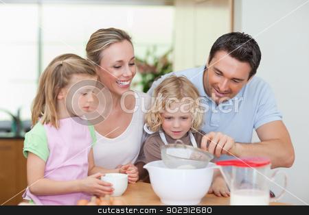 Family preparing dough stock photo, Family preparing dough together by Wavebreak Media