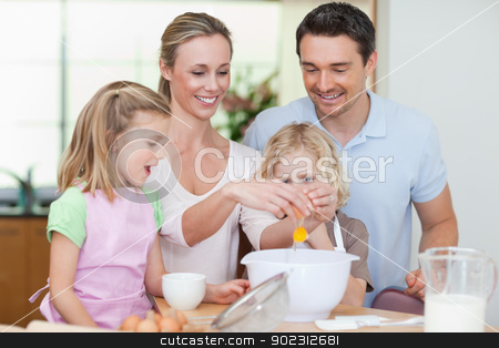 Family making dough stock photo, Family making dough together by Wavebreak Media