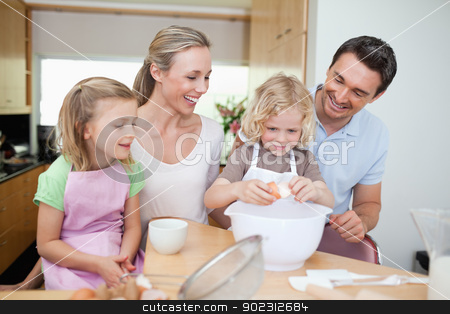 Family preparing cookies stock photo, Family preparing cookies together by Wavebreak Media