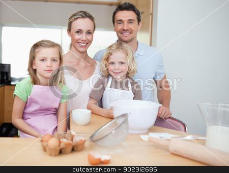 Happy family preparing cookies stock photo, Happy family preparing cookies together by Wavebreak Media