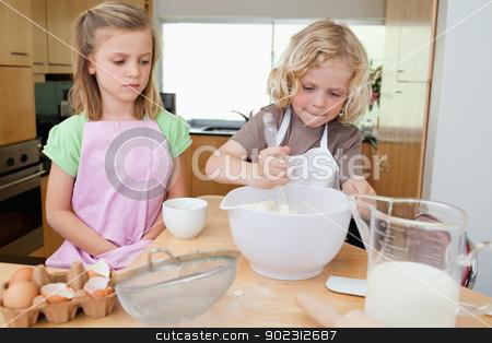 Young siblings preparing dough stock photo, Young siblings preparing dough together by Wavebreak Media