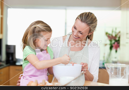 Mother and daughter having fun in the kitchen stock photo, Mother and daughter having fun together in the kitchen by Wavebreak Media
