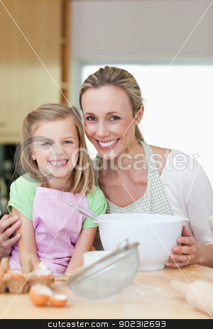 Mother and daughter having good time in the kitchen stock photo, Mother and daughter having a good time in the kitchen by Wavebreak Media