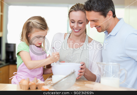 Family making cookies stock photo, Family making cookies together by Wavebreak Media