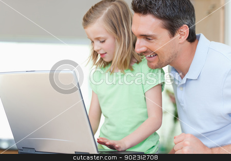Father and daughter with notebook stock photo, Father and daughter together with notebook by Wavebreak Media